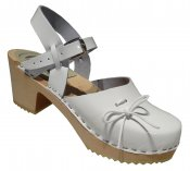 Mary Jane - White patent leather on a natural high (7 cm) base, white leather bow
